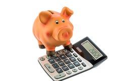 Piggy Querneigung und Taschenrechner stockfoto
