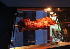 Piggy roasting on a spit in the evening street in Prague, Czech Republic stock photo