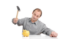 Piggy robbing. Man robbing the piggy bank with hammer Royalty Free Stock Photos