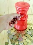 piggy sättande sparande för grupppengar Royaltyfri Fotografi