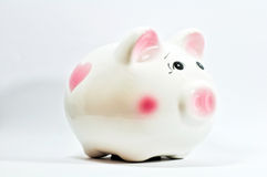 Piggy saving box. A piggy saving box on white background Royalty Free Stock Images