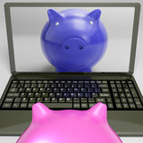 Piggy On Screen Shows Internet Investment Savings Royalty Free Stock Photo