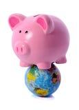 Piggy on world Stock Photos