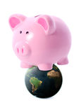 Piggy on world Royalty Free Stock Image