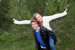 Piggyback. Happy smiling fun piggyback couple Stock Photography