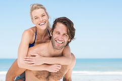 Piggyback on beach Royalty Free Stock Images