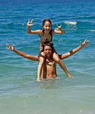 Piggyback (brother and sister) on sea. Brother and sister - children (on shoulder - piggy back) in summer vacation at Adriatic sea Stock Photography