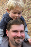 Piggyback with daddy Stock Images