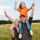 Piggyback family outdoors Stock Photos