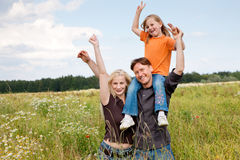 Piggyback family outdoors Royalty Free Stock Photos