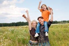 Piggyback family outdoors Royalty Free Stock Photos