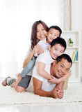 Piggyback fun. Asian family having piggyback fun Stock Images