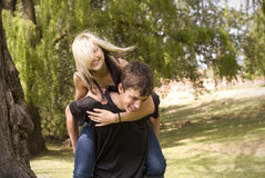 Piggyback girl on back Royalty Free Stock Photos