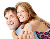 Piggyback laughing couple in studio Stock Photography