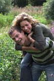 Piggyback ride in the garden Royalty Free Stock Images