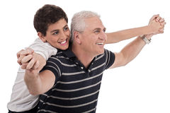 Piggyback ride given by grandfather Royalty Free Stock Photo