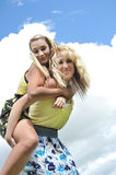 Piggyback ride with two teenage Stock Image