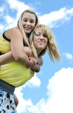 Piggyback ride with two teenage girls Royalty Free Stock Images