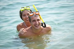 Piggyback in water Stock Photography