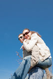 Piggyback. Young man and woman outdoors Stock Images