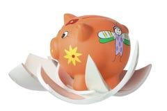 Piggybank和残破的片断 库存照片