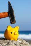 Piggybank. Closev up of yellow piggybank with hammer stock photos