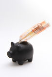 Piggybank with an airplane of money Royalty Free Stock Photos