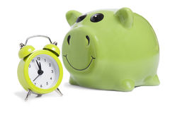 Piggybank and alarm-clock. As concept for savings Royalty Free Stock Photos
