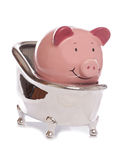 Piggybank in a bath Stock Photos