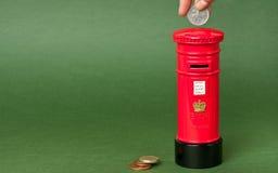 Piggybank británico del mailpost Fotos de archivo libres de regalías