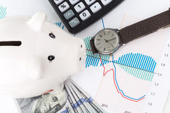 Piggybank and calculator Royalty Free Stock Photo