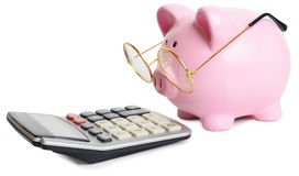 Piggybank and calculator Royalty Free Stock Photo