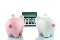 Piggybank and calculator, saving target Stock Photography