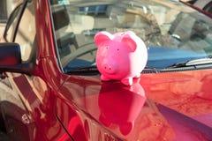 Piggybank On Car. Close-up Of A Piggybank On New Car stock photo