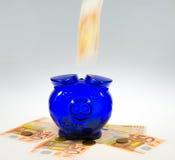 Piggybank on cash Stock Photography