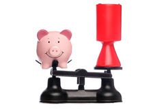 Piggybank and charity collection on scales Stock Images