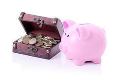 Piggybank with chest Royalty Free Stock Image