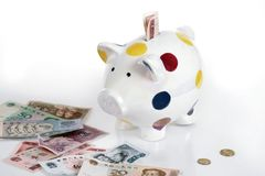 Piggybank and chinese currency Royalty Free Stock Photo