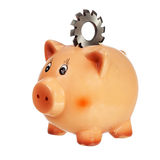 Piggybank with circular cutter on back Stock Photo