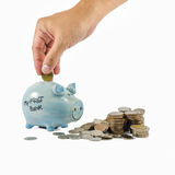 Piggybank and coins with hand Royalty Free Stock Photography