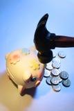 Piggybank com martelo Imagem de Stock Royalty Free