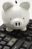 Piggybank on computer keyboard Stock Image