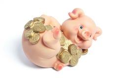 Piggybank con le monete Fotografie Stock Libere da Diritti