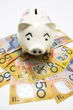 Piggybank on Dollar Notes Royalty Free Stock Photos