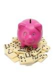 Piggybank with Dominoes Stock Photography