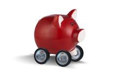 The piggybank driving away on wheels Stock Image