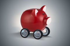 The piggybank driving away on wheels 3d rendering Stock Photos