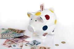 Piggybank e moeda chinesa Foto de Stock Royalty Free