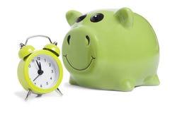Piggybank en alarm-klok Royalty-vrije Stock Foto's