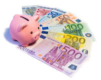 Piggybank on euro banknotes Stock Images